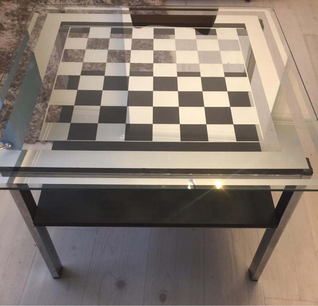 Mirrored chess style glass occasional chrome table. Father's Day??
