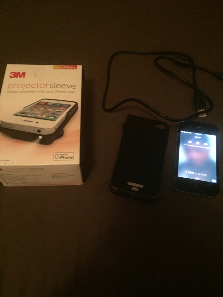 iPhone 4 8 gb black with 3m sleeve projector with box and charger dock.