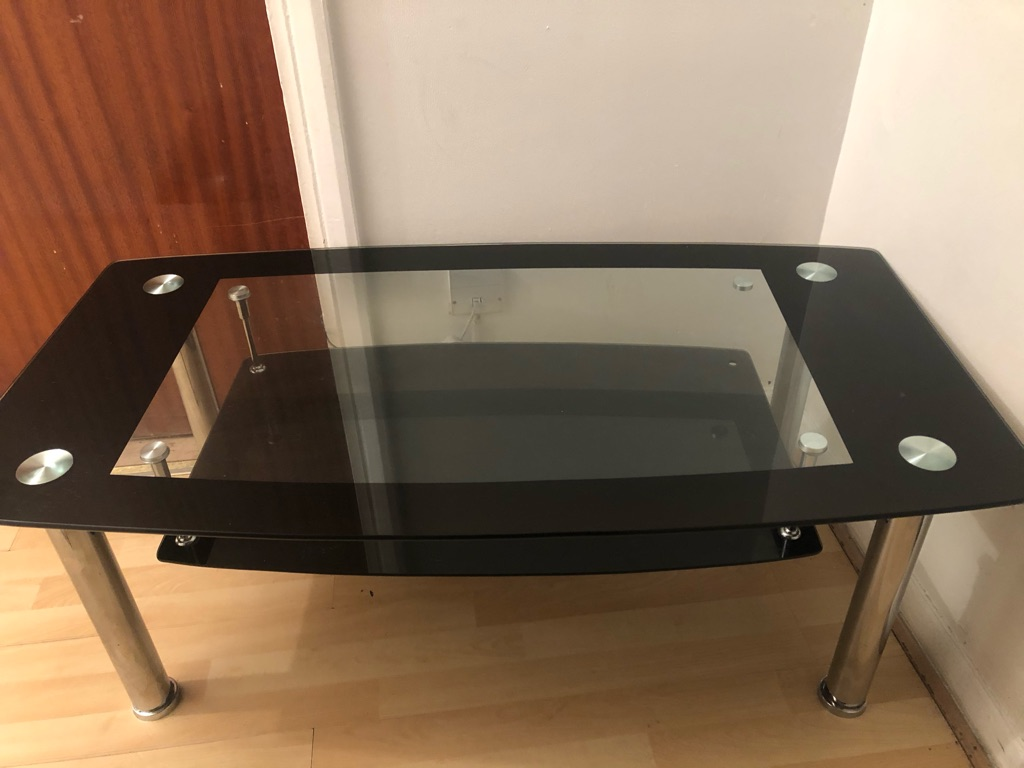 Black coffee table and small black tv stand