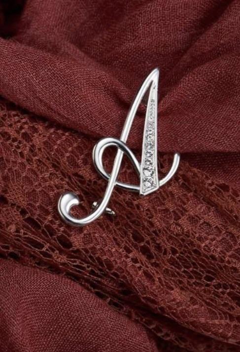 Initial brooch