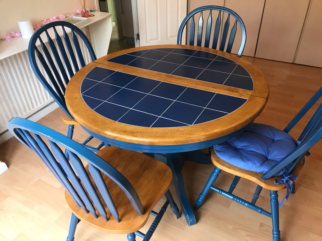 Solid round dining room table