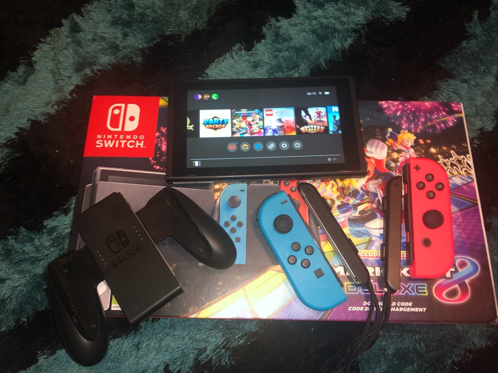 Nintendo Switch with Mario Kart 8 and Lego Harry Potter