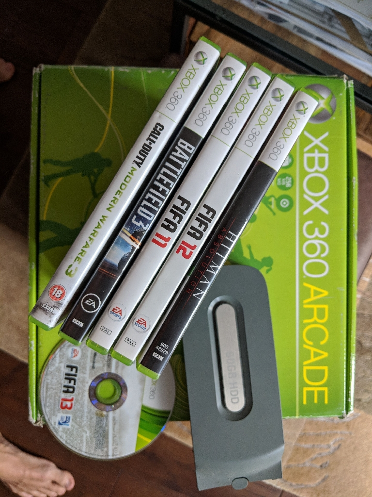 Xbox 360 with 60GB hard drive wireless controllers and games