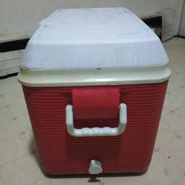 Red and white rubbermaid cooler