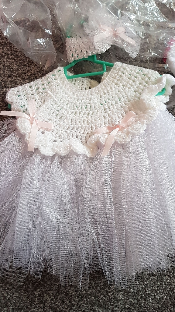 Newborn hand knitted dress