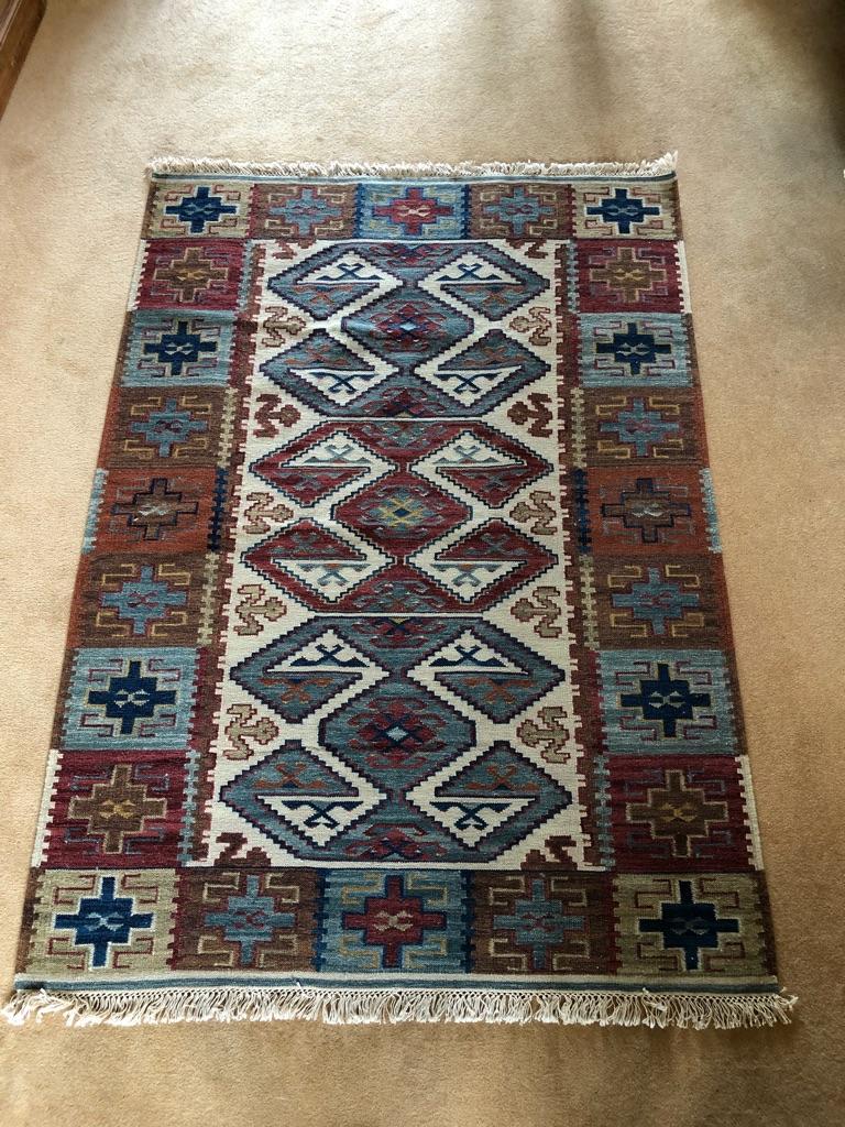 Selection of wool rugs unused
