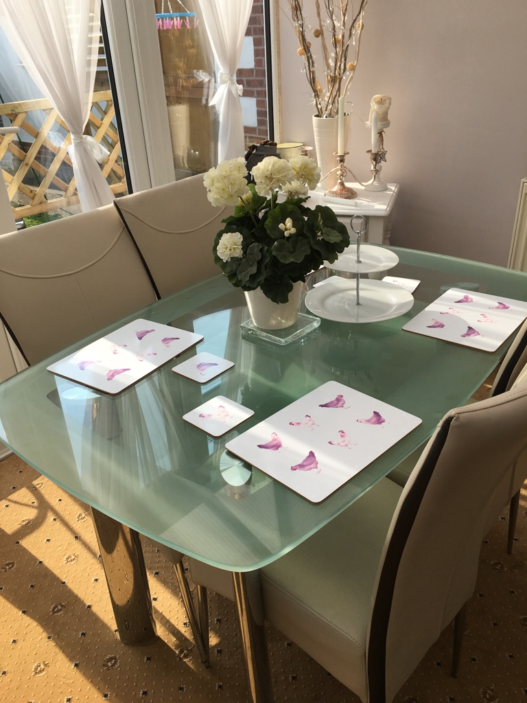 Harvey's Glass dining table and 4 chairs