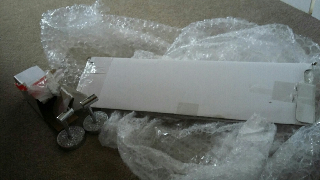 Brand new unused glass bathroom shelf with silver sparkle fixings