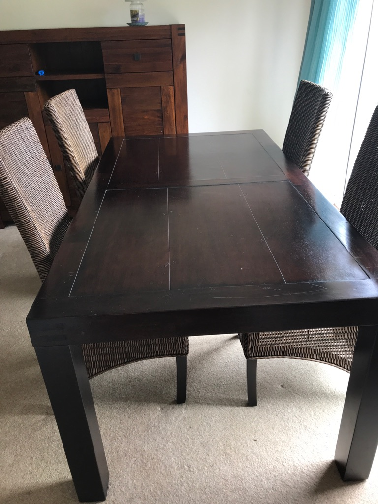 Beautiful dark solid wood dining set.
