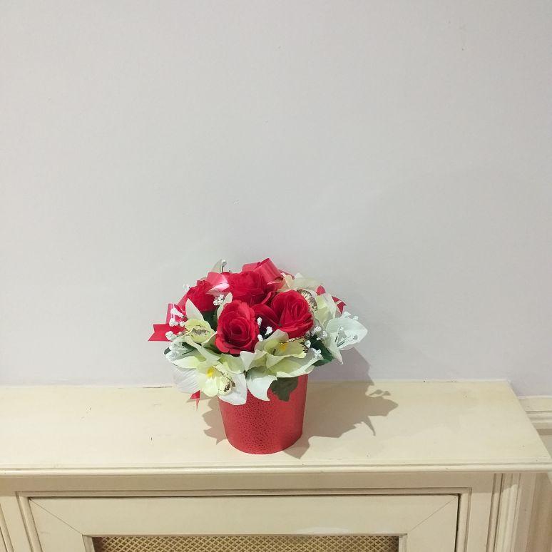 Bright silk arrangement in sparkly container