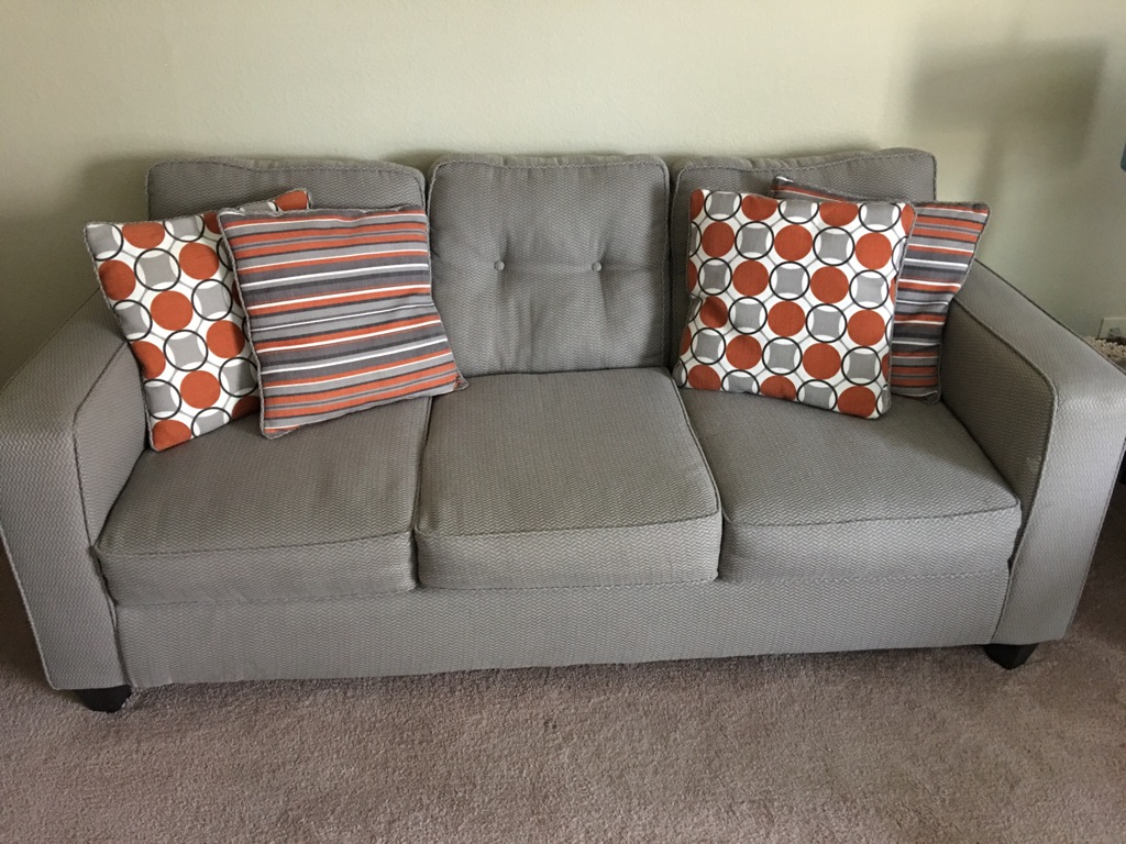 Gray fabric sofa and love seat with throw pillows