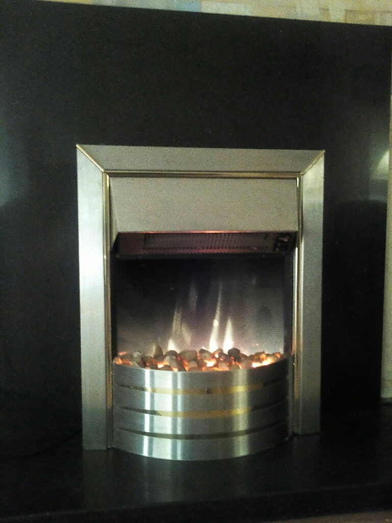 Black marble plinth and black marble fire surround including fire
