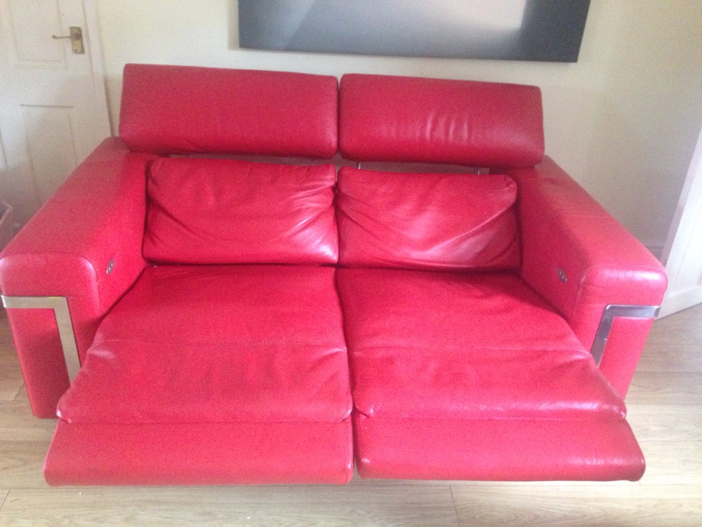 Red recliner sofa.