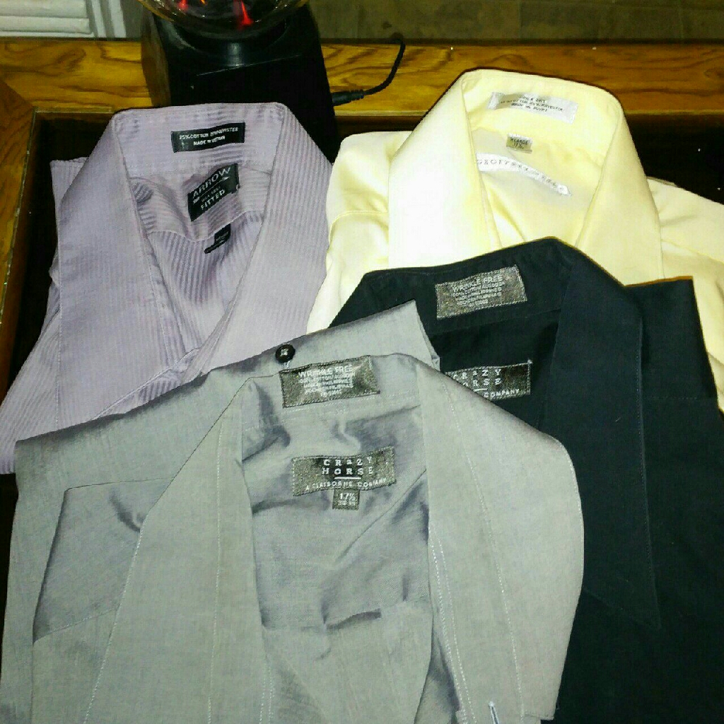 Lot of 4 men's dress shirts.