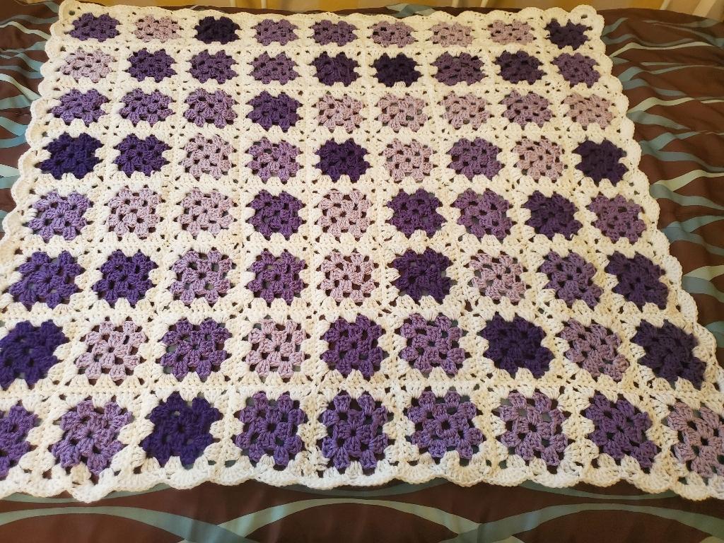 Purple and white granny square afgan