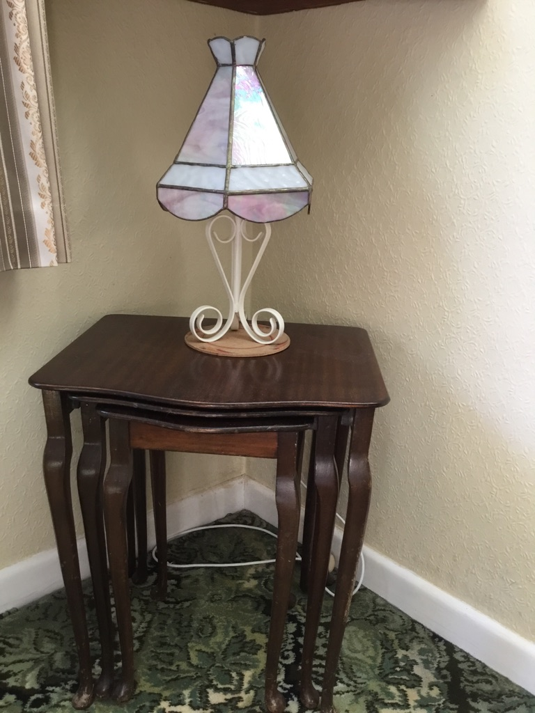 Nest of side tables and glass shaded lamp