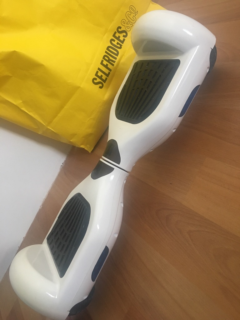 White Segway/Hoverboard with charger and cover bag