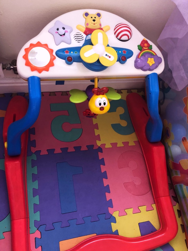 Baby seating and standing toy