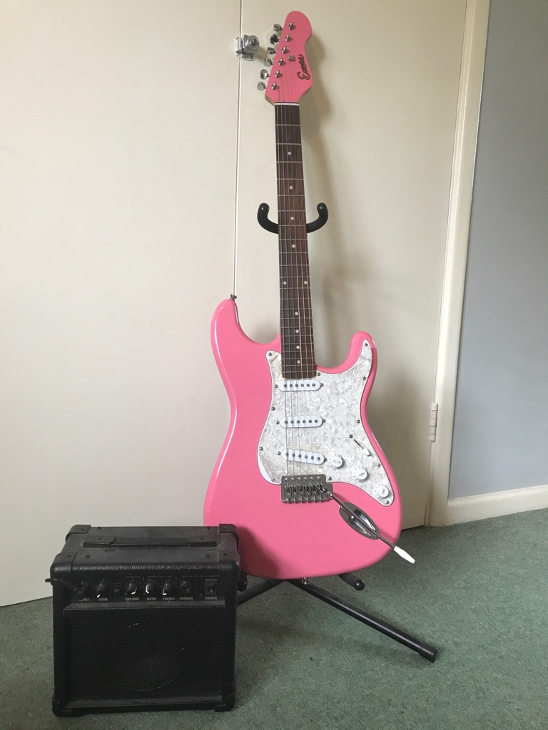 Pink electric guitar (with case, amp, stand, strap, capo)