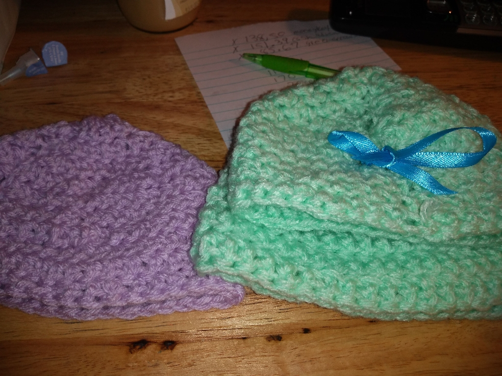 Crocheted newborn baby hats