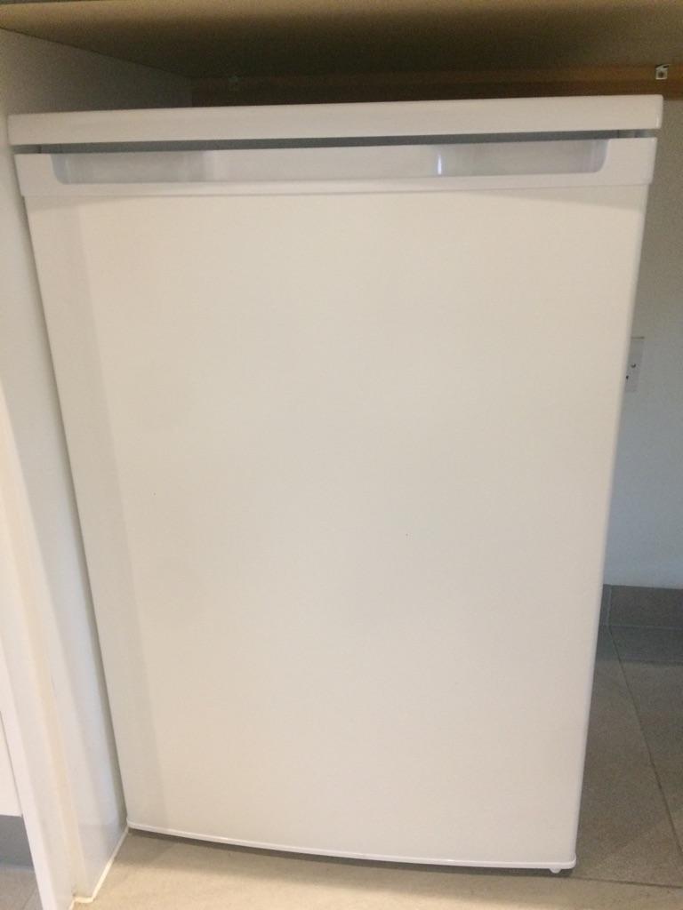 Fridge with freezer comportment