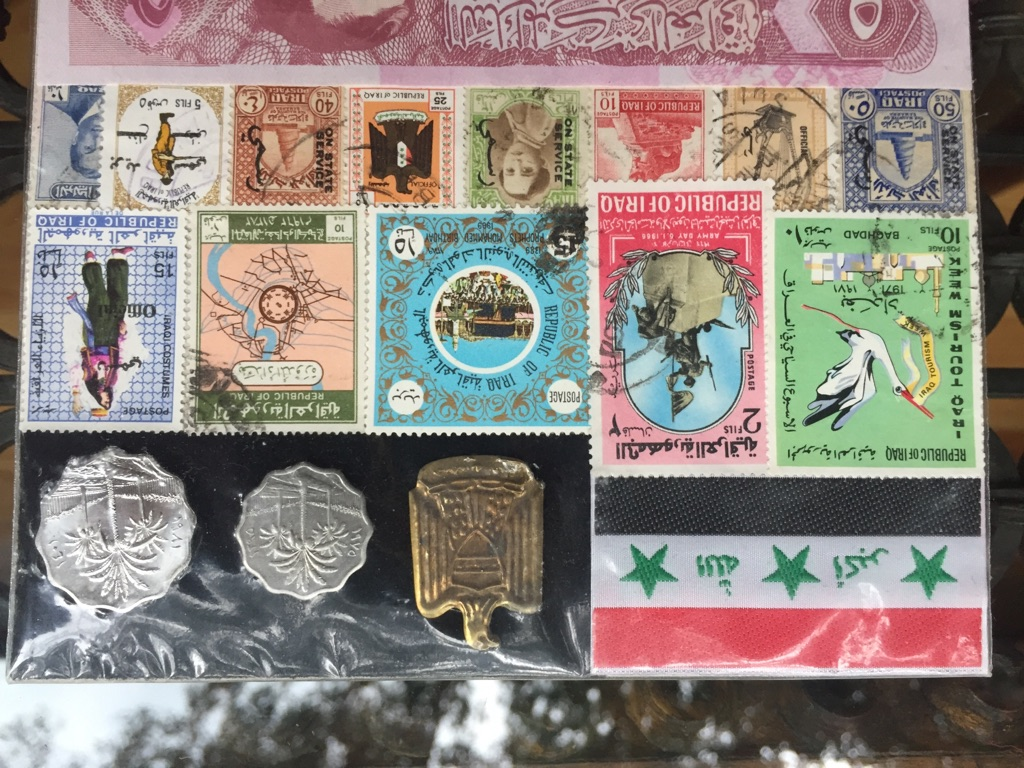 Collection of stamps and currency /Iraq