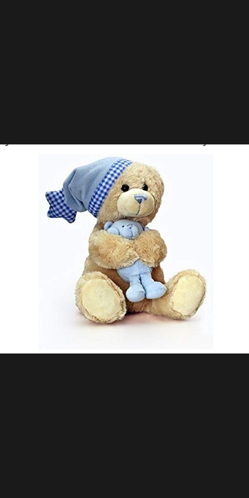 "Adorable ""KEEL MUSICAL TEDDY BEAR"" , a top quality musical Teddy bear from Keel that plays a lullaby when his hat is pulled, seated in a silver effect board and gift wrapped with cellophane and ribbons, would make an ideal Birthday gift  for a pre school child or for a baby shower, christening, new arrival. From a smoke free home."