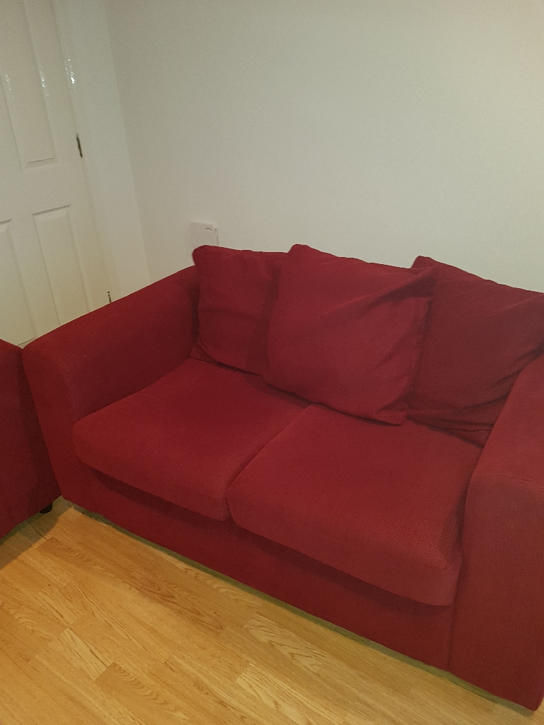 Two seater red sofas