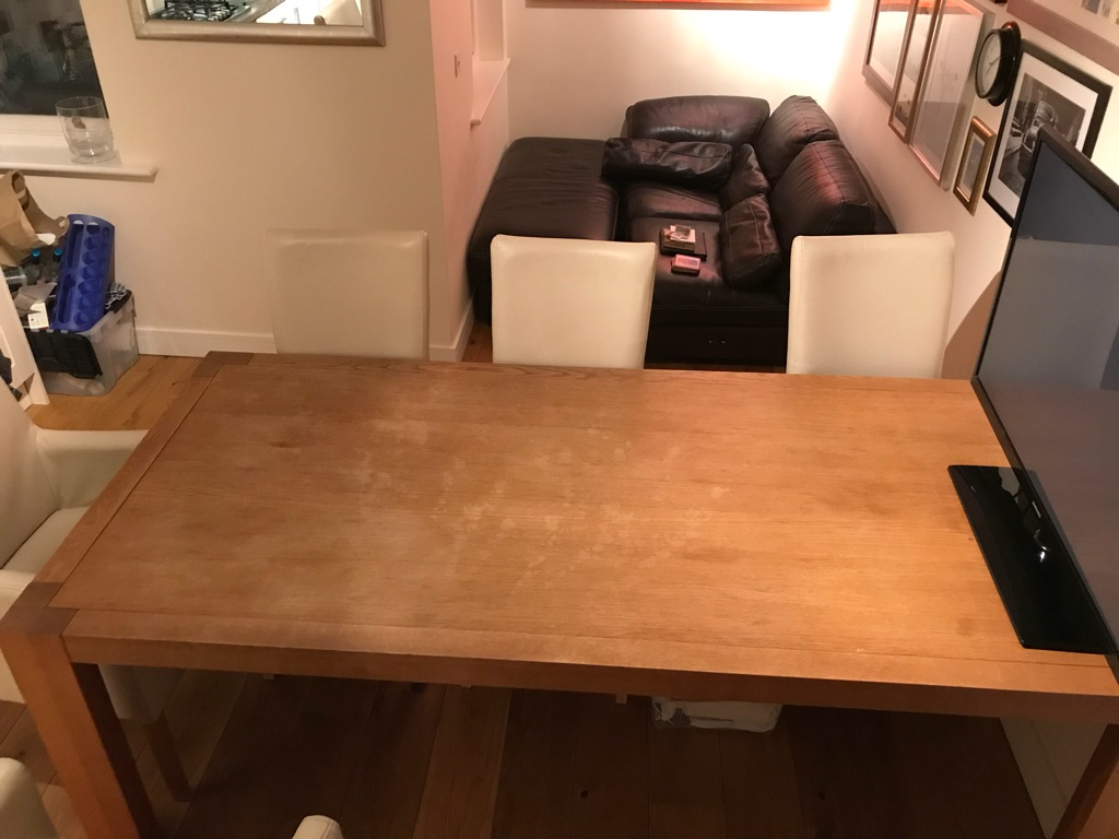 Oak dining table with 8 cream leather chairs
