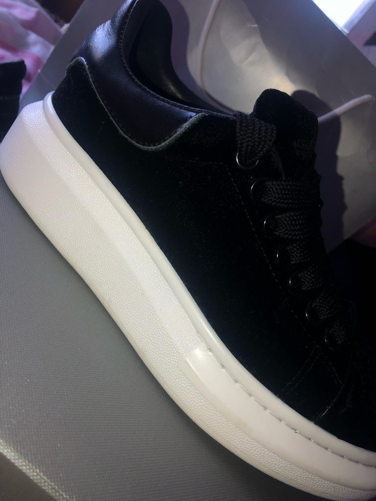 Black mcqueens size 4