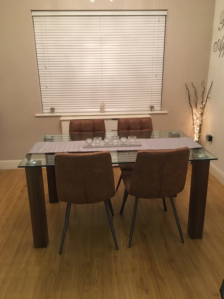 Beautiful Glass Topped Dining Table and 4 Matching Faux Leather Dining Chairs For Sale