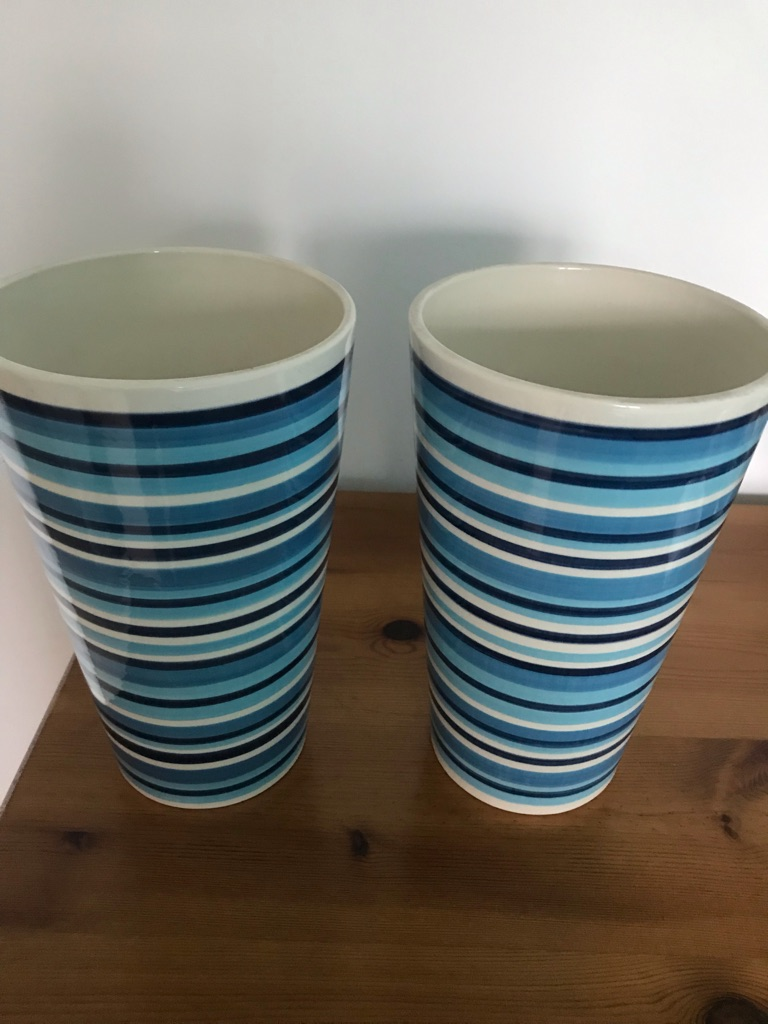 Pair of pottery vases in modern blue circular stripes