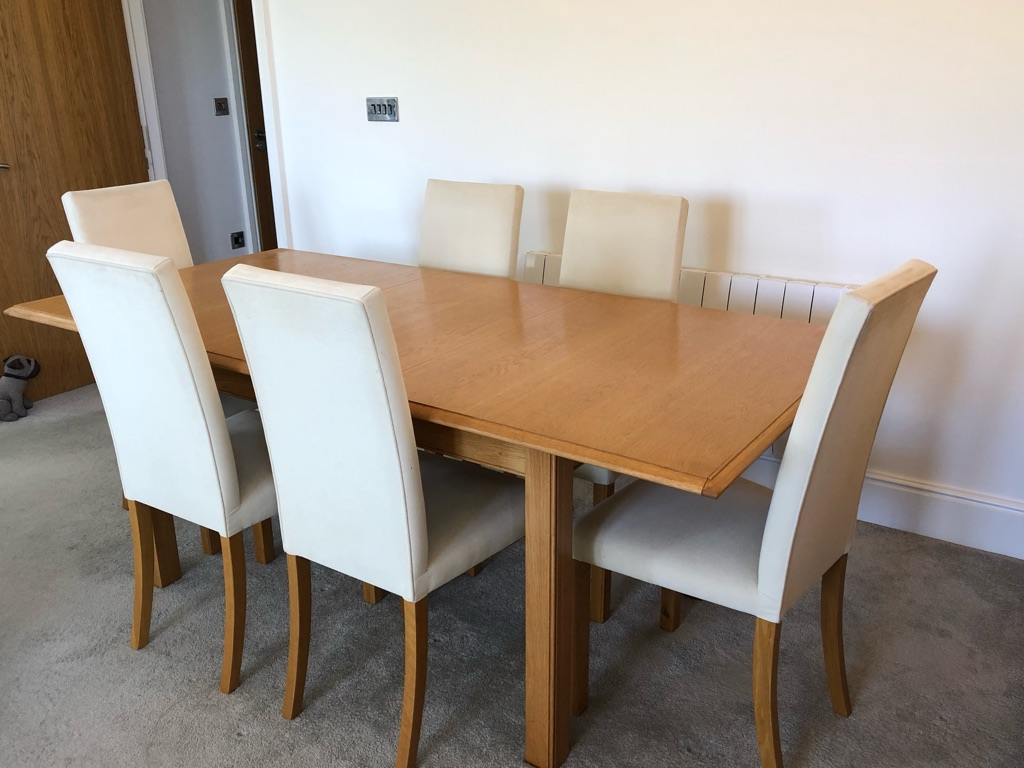 Extendable dining room table and 6 cream chairs