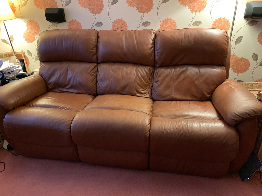 Three seater DFS leather reclining sofa.
