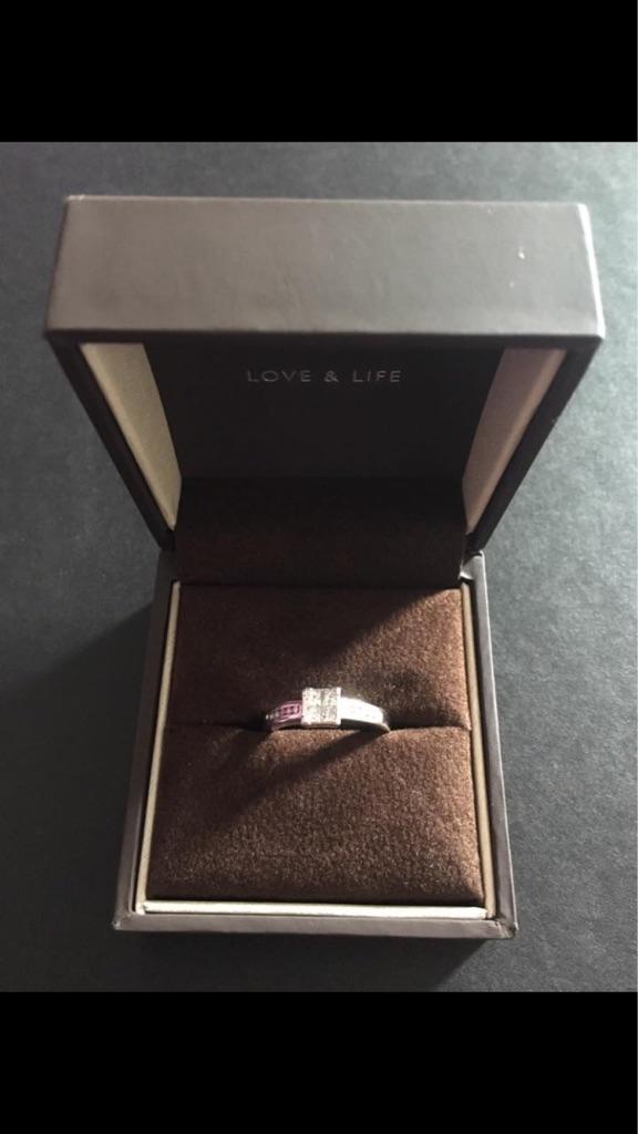 Platinum diamond cluster engagement ring