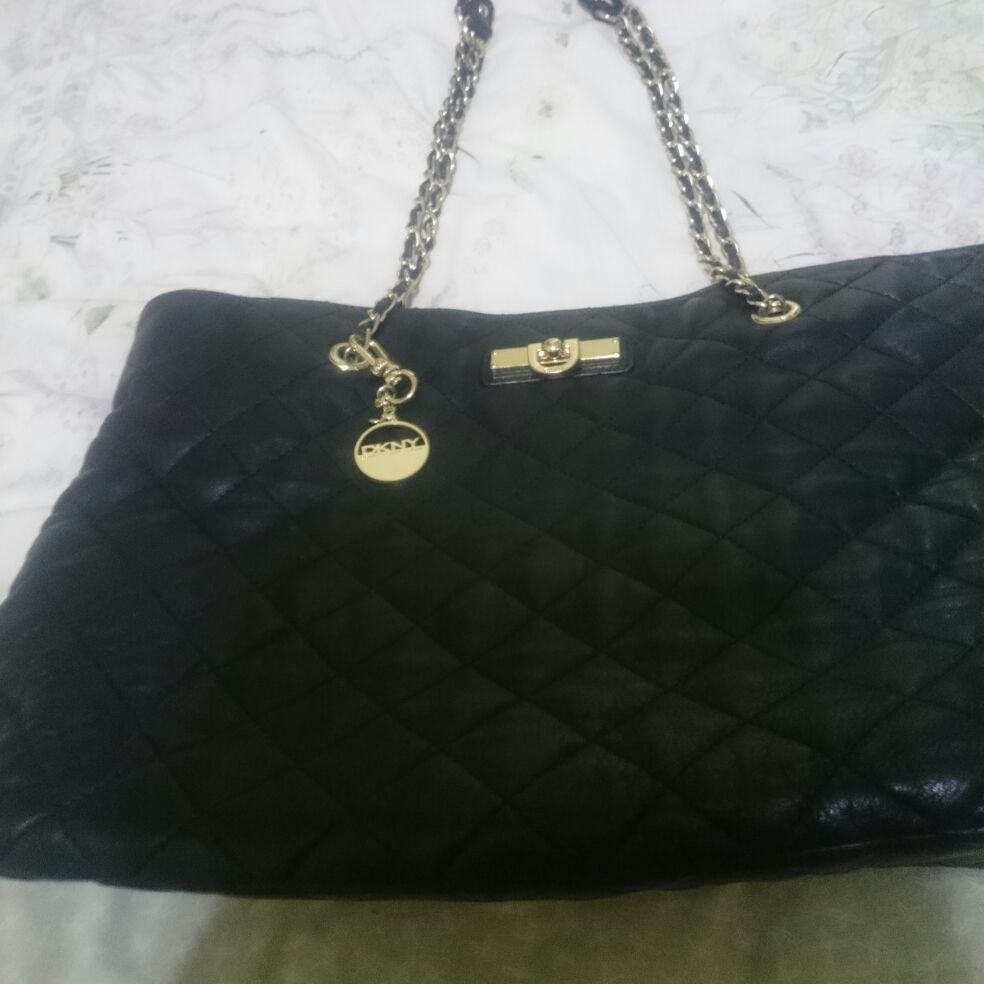 Medium size genuine DKNY black quilted style shoulder strap bag with dustbag included, preowned, excellent and clean condition