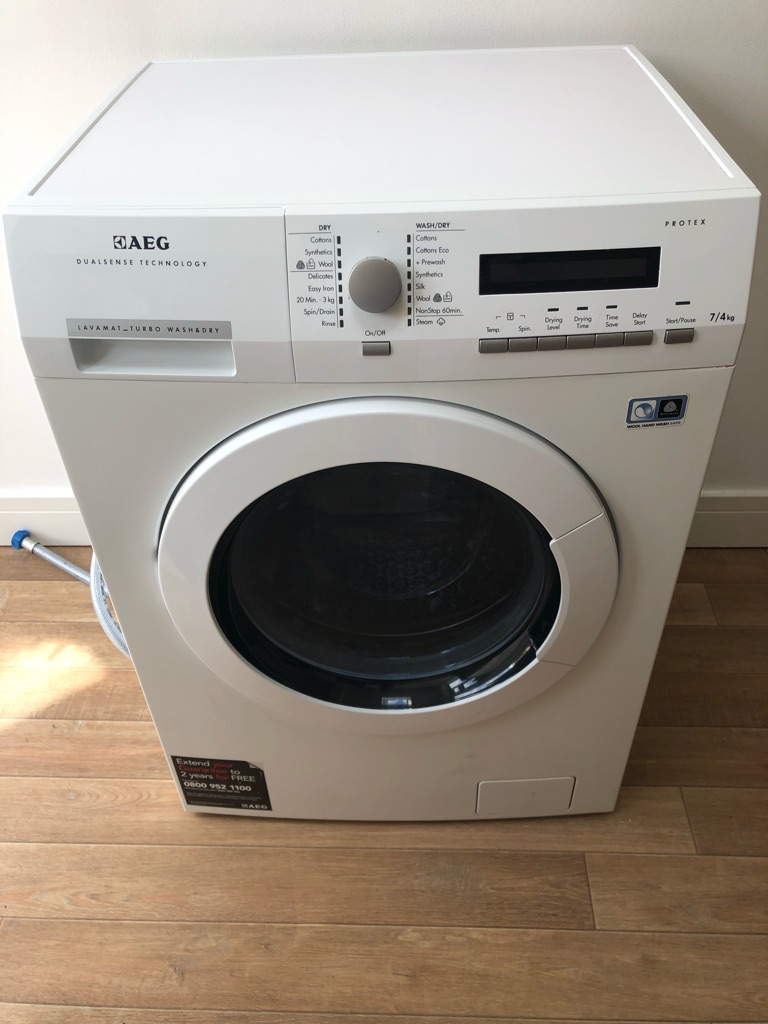 AEG freestanding washer dryer 7kg Wash/4kg Dry Load, A Energy Rating, 1600rpm Spin, White