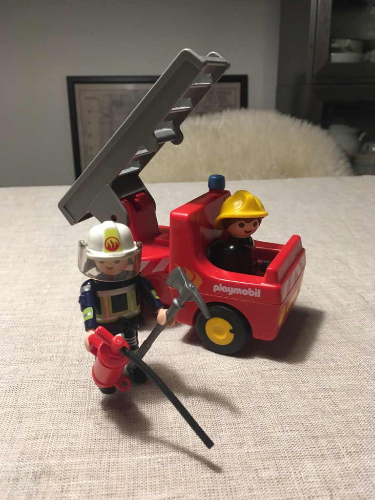 Playmobile fire engine and 2 figures
