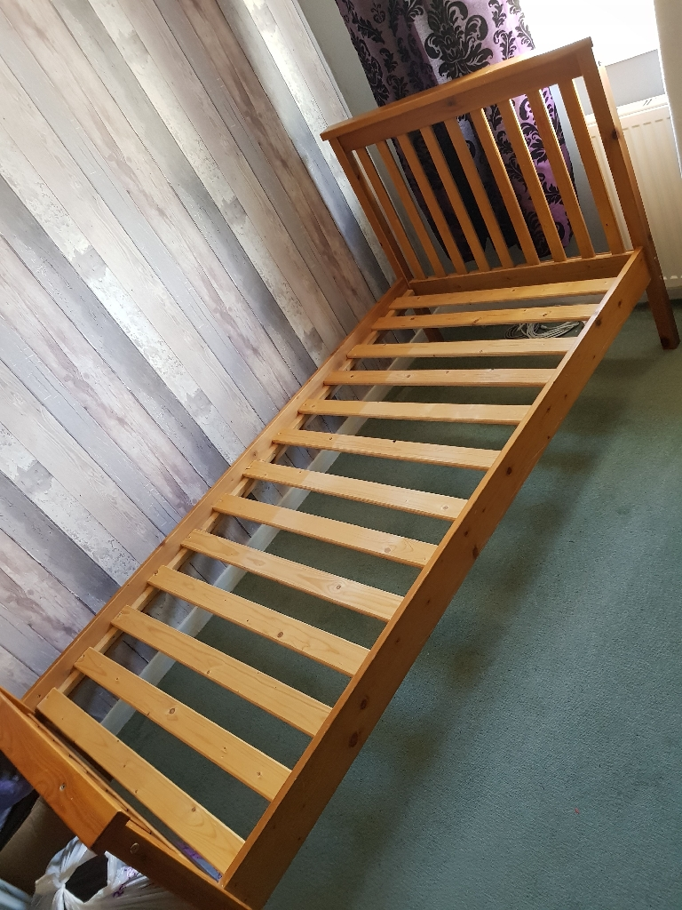 Single wooden bed in good condition.