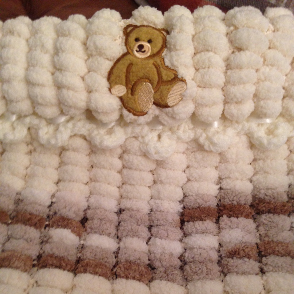 Baby's hand knitted pram cover