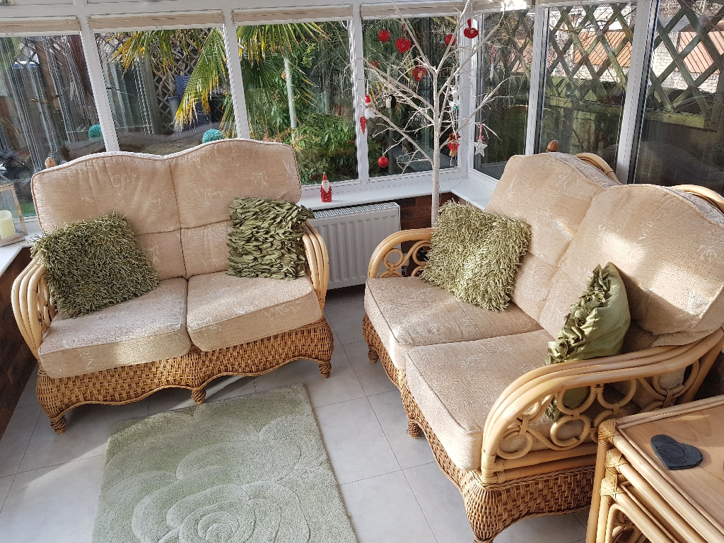 2 x 2 seater conservatory sofas including cushions and matching nest of 2 tables