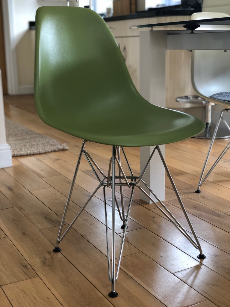 Green Eames-style dining chairs x4