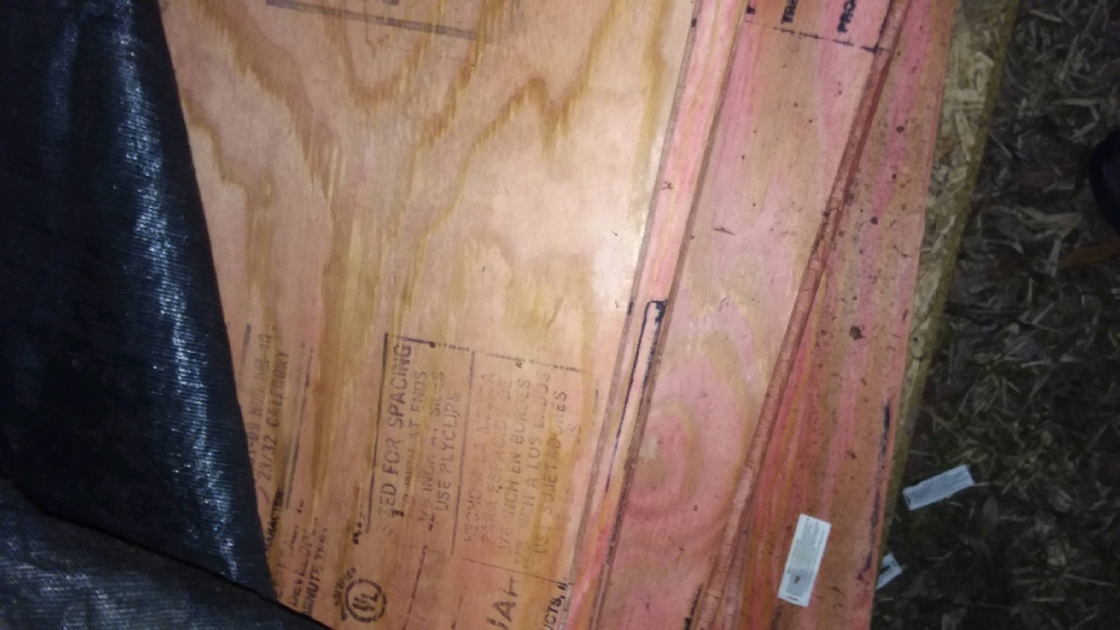 Pink 3/4 inch pressure  treated pyro guard and tongue groove 4×8 plywood