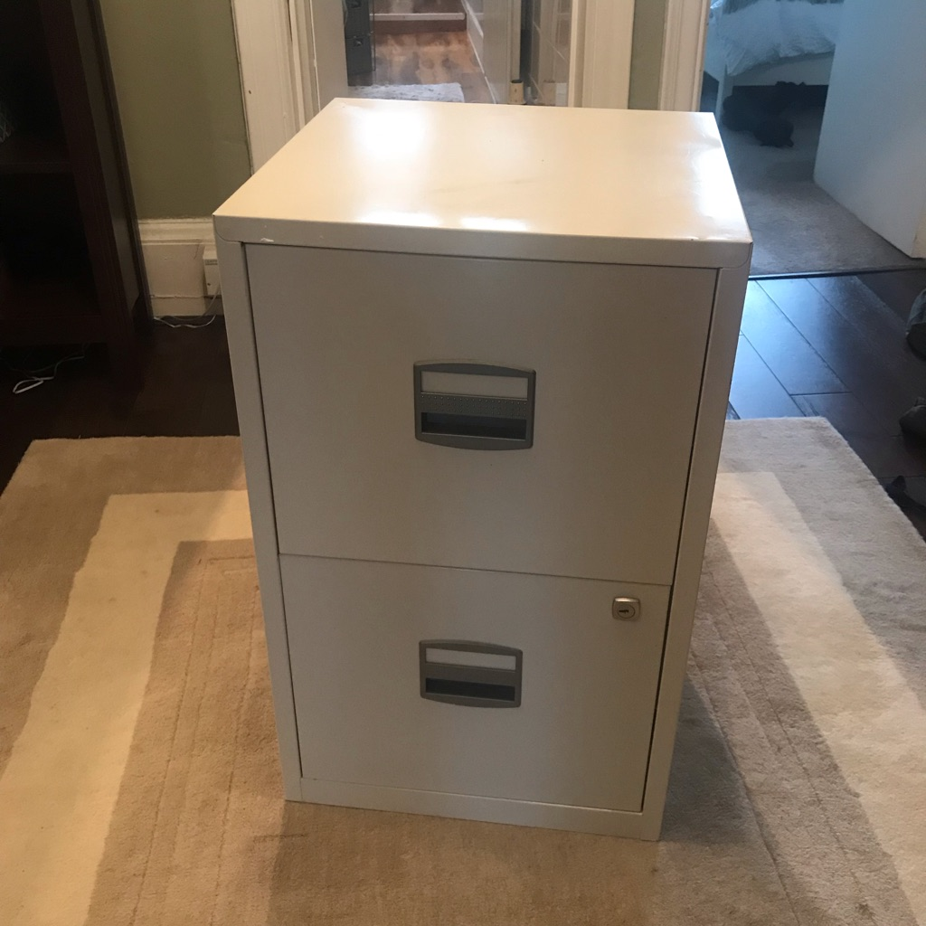 Two drawer white filing cabinet.