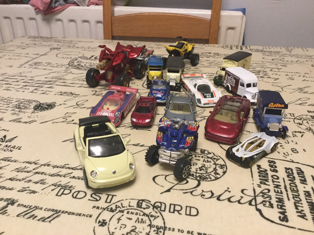A selection of toy cars and other vehicles