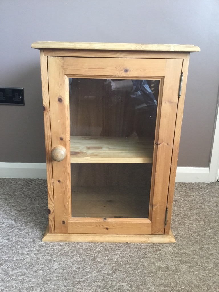 Pine cupboard with glass door
