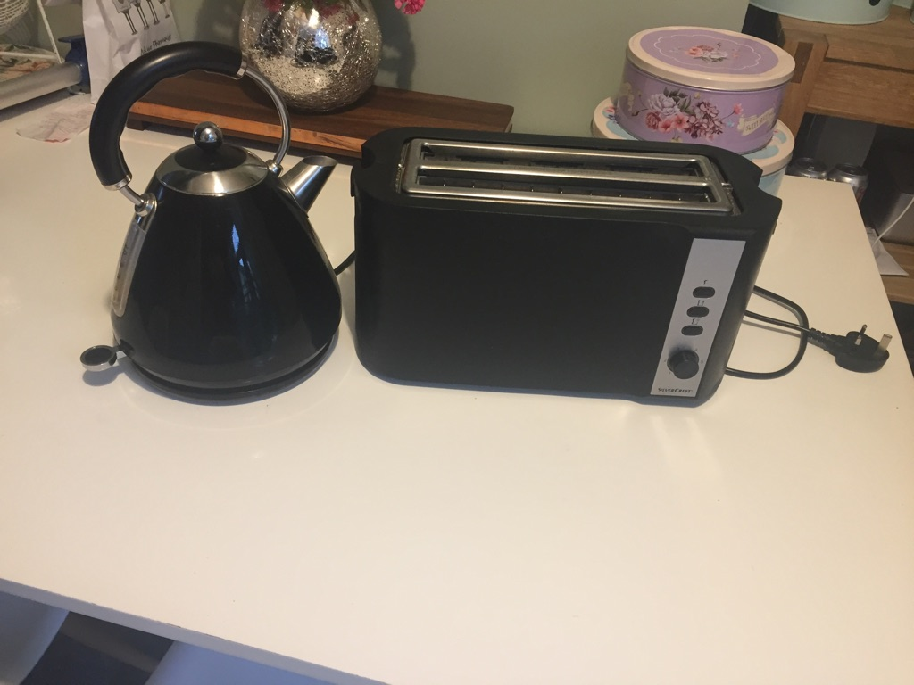 Black and silver kettle and toaster