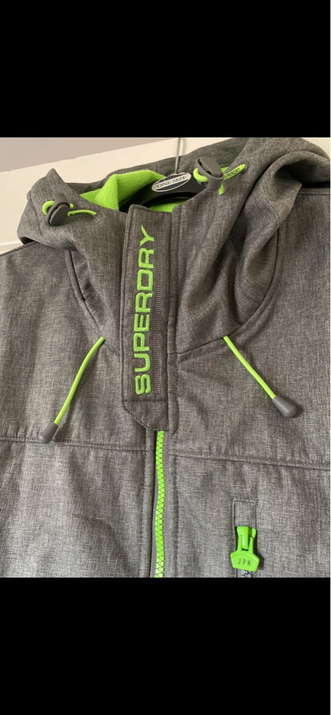 Brand new superdry fleece lined warm coat in Large