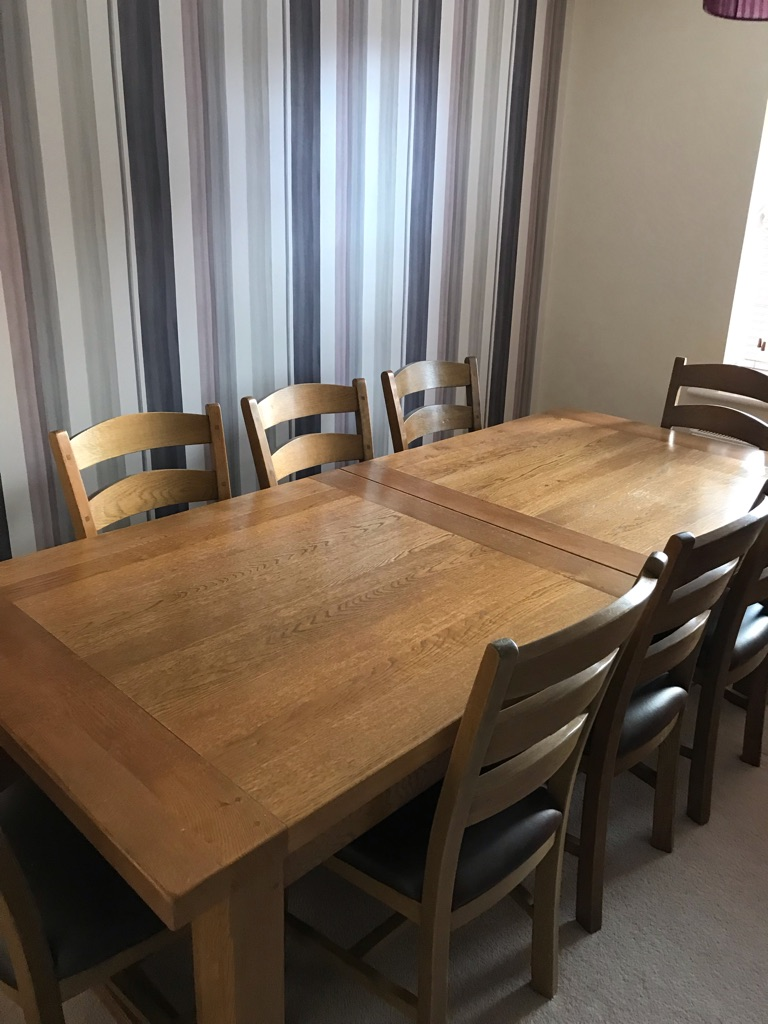 12 seater oak dining table and 10 matching chairs