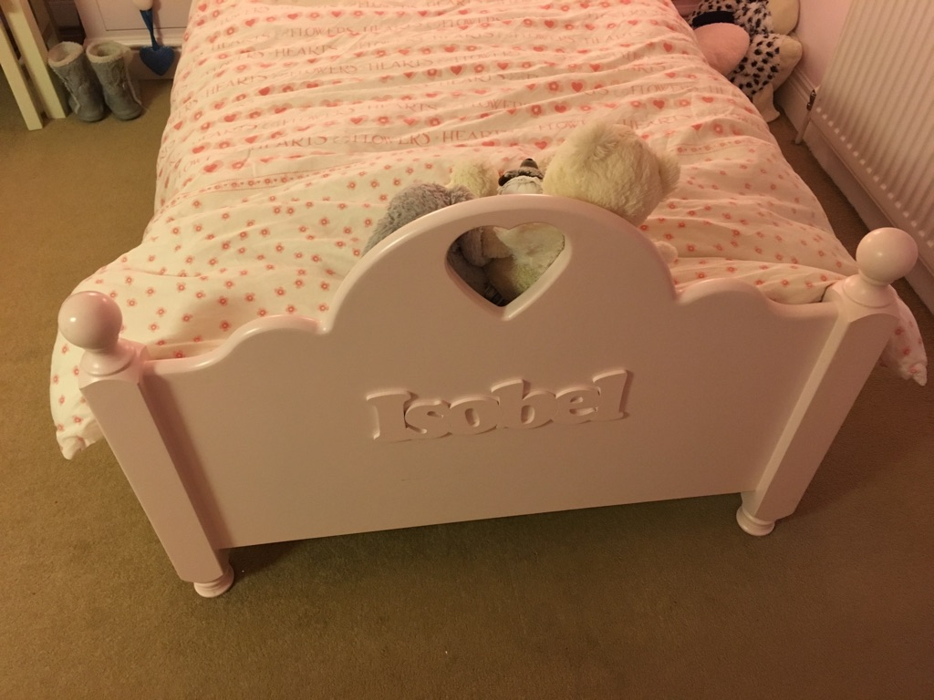 Pink kids bed from Little Lucy Willow, with the name  'Isobel' on the foot of the bed